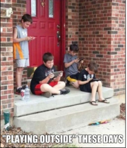 Kids playing outside on computers